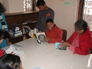 Ajaya, Manoj and Sarvana reading in the new library