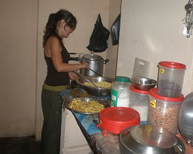 Maelle, from Children of Asia, cooking in the kitchen @ the new house