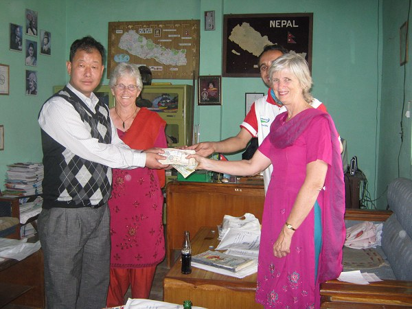 Rajesh Rai. Principal of East-Pole school receiving   funds for DHC New Life school fees donated by Sue Driscoll and her   family and friends in Australia and Canada, and Dale MacLean and Rick  Nelson in USA.